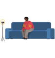 man is recording video on smartphone guy on sofa vector image vector image
